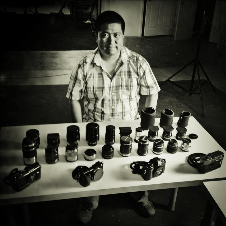 Leica, Fuji, Sony and Olympus lenses and cameras.  Photo by Rinzi Ruiz
